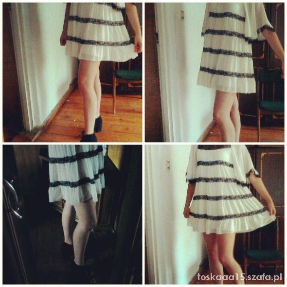 Eleganckie Biała sukienka z dodatkami koronki lipsy