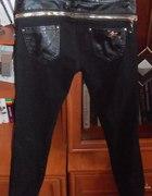 Czarne spodnie ze skórzanymi wstawkami
