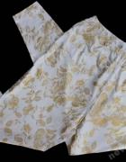 Białe legginsy w złote ornamenty