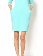 Pikowana sukienka z kieszeniami tuba bombka M