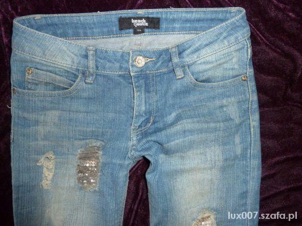 Spodnie Jeansy z dziurami dziury skinny biodrówki XS dzety