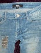 Jeansy z dziurami dziury skinny biodrówki XS dzety...