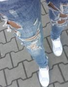 Spodnie dziury przetarcia
