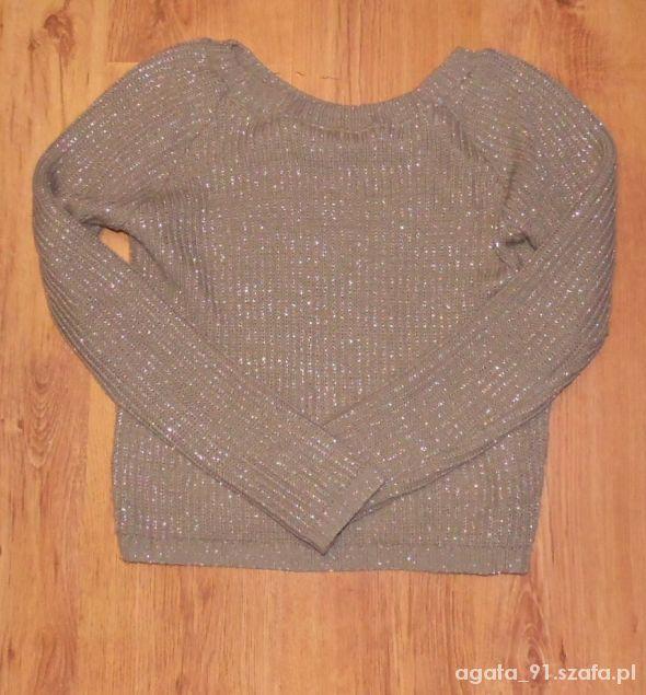Ciepły sweter ze srebrną nitką 38