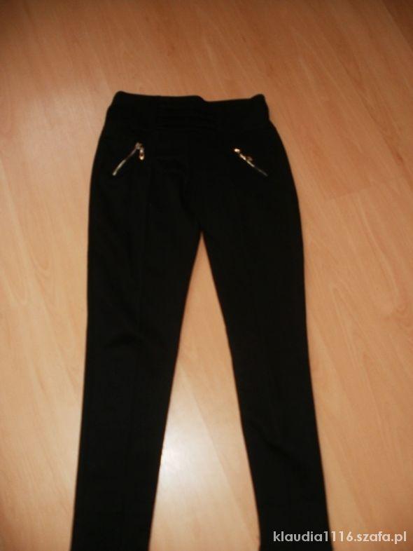 Spodnie Śliczne eleganckie czarne spodnie NOWE