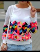 Kolorowa bluzka z zamkami