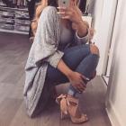 Obszerny sweterek i piękne buty