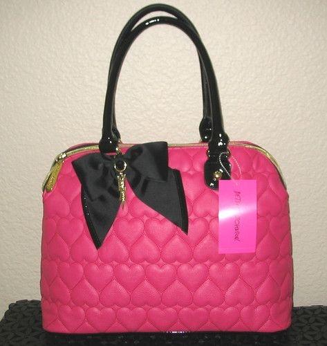 Torebka z różowymi serduszkami i czarną kokardką