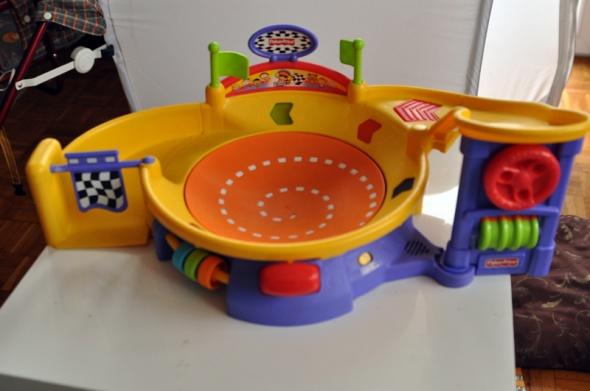 Zabawki Muzyczny wiraż fisher Price tor wyscigowy