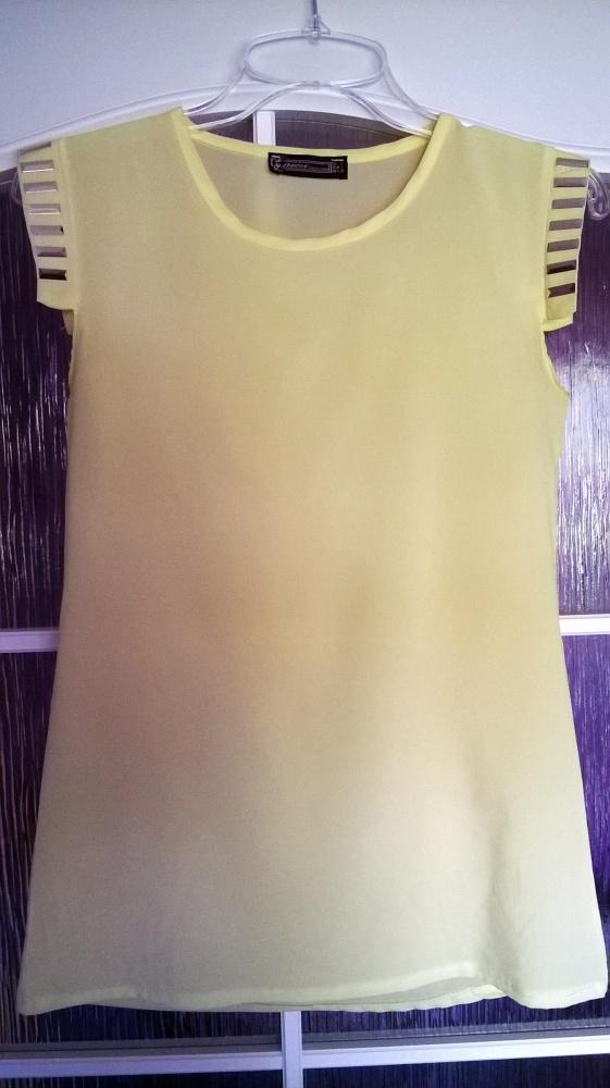 Śliczna elegancka cytrynowa bluzeczka