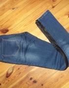 jeansy slim fit skorzane wstawki na bokach 34