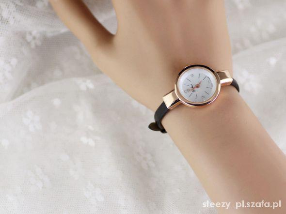 zegarek na pasku elegancki złoty kolory kryształki