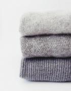 szare swetry
