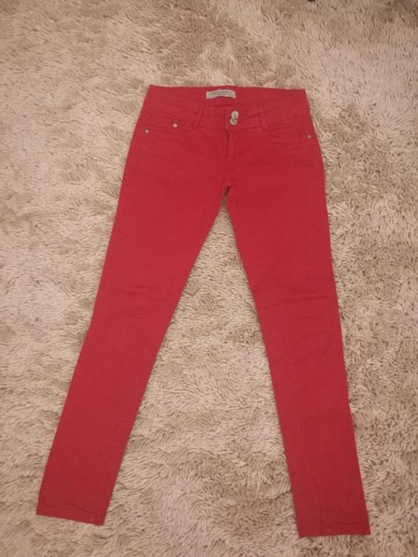 Spodnie Czerwone jeansy rurki tanio C&A