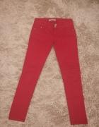 Czerwone jeansy rurki tanio C&A
