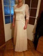 Elegancka prosta suknia slubna i gipiurowe bolerko