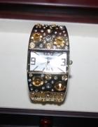 Zegarek damski złoty ozdobny na bransolecie