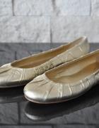 Złote marszczone baleriny Prada