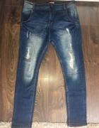 Spodnie jeansy z obniżonym krokiem Terranowa L 40