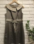 Srebrna sukienka z kokardką
