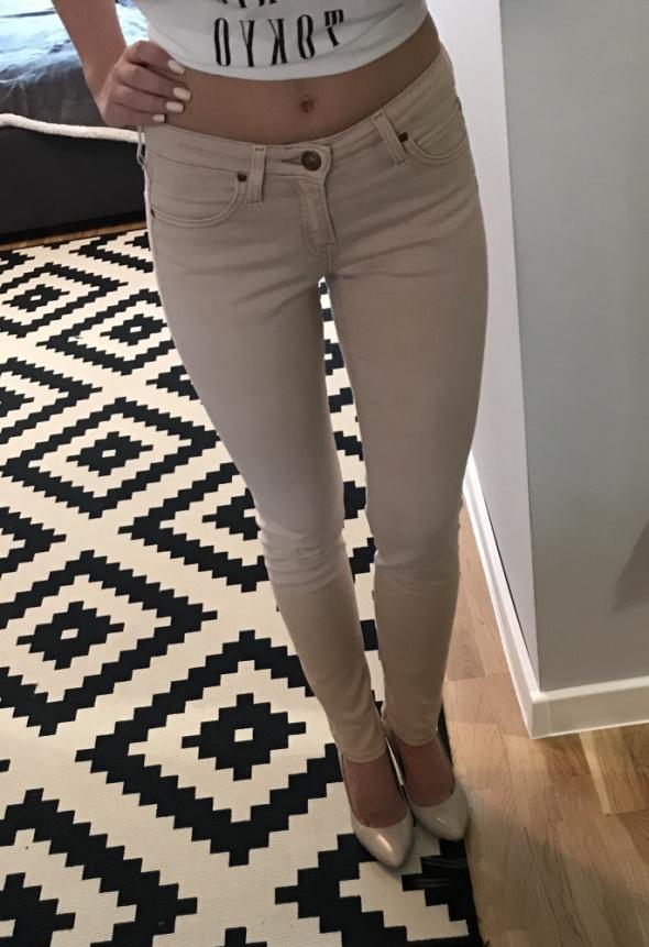 Spodnie Spodnie rurki Lee pudrowy róż S W26 L31