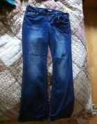 Szerokie jeansy Promod 42