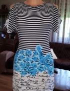 Letnia sukienka odsłaniająca ramiona