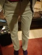 Letnie spodnie w kolorze beżowym...
