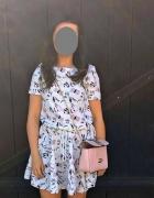 rozkloszowana sukienka cocomore printy torebki but