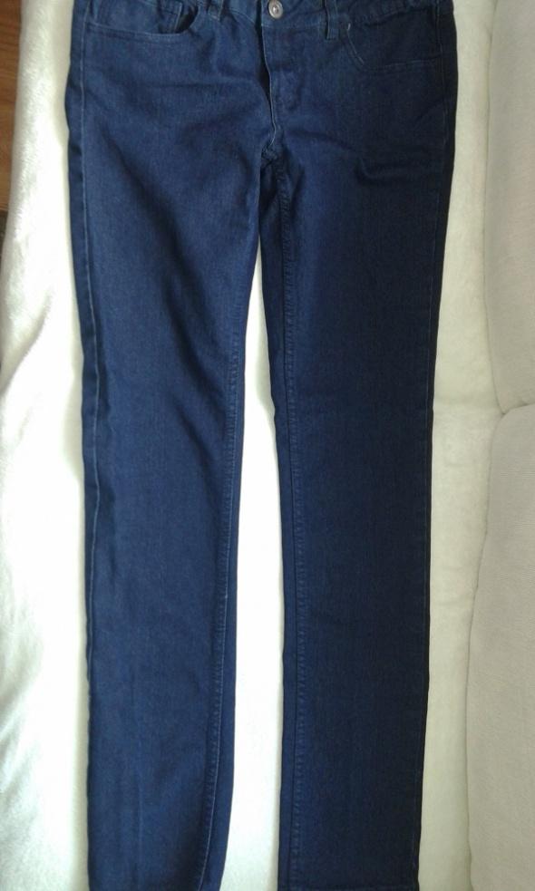 nowe spodnie rurki dżinsowe damskie skinny...