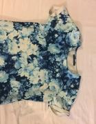 Niebieska bluzka w kwiatki house