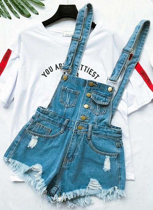 Jeansowe ogrodniczki dziury