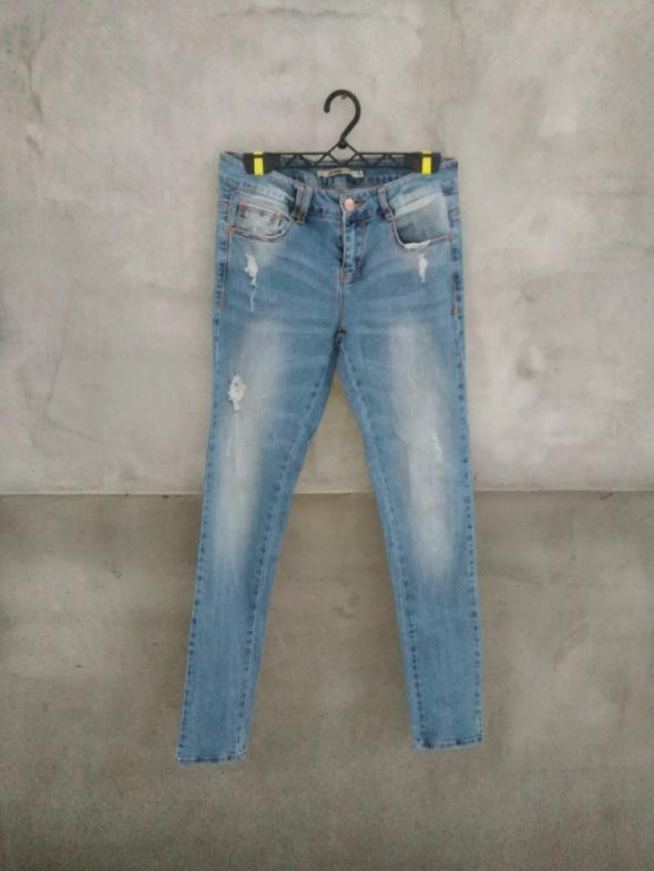 Spodnie Spodnie z dziurami hit sezonu spodnie jeansowe rozmiar S