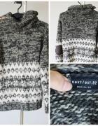 Zimowy sweter we wzory...
