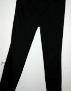 eleganckie spodnie Mango...