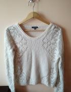 Biały ażurowy sweterek...
