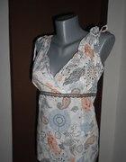 Świetna bluzeczka z dekoltem i odkrytymi plecami M