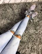 dopasowane rurki jeans dziury perełki 36