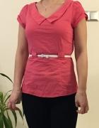 Elegancka różowa bluzka z paseczkiem