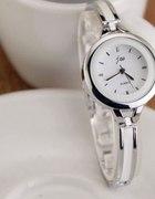 zegarek cienka srebrna złota bransoleta elegancki