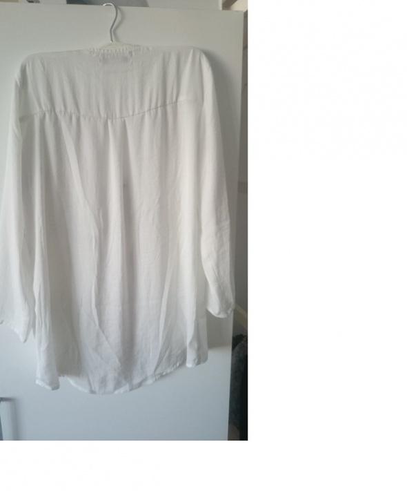 Biała koszula z suwakiem...