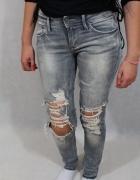 szare spodnie jeansowe z przetarciami s...