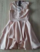 Koronkowa rozkloszowana sukienka...