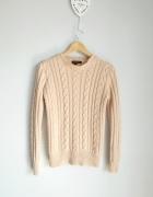 Atmosphere pastelowy sweter warkocze...