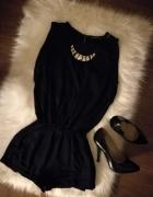 Klasyczny kombinezon i elegancka czerń...