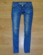 133 Spodnie jeansowe damskie rurki 27