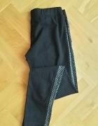 Czarne legginsy z cekinami