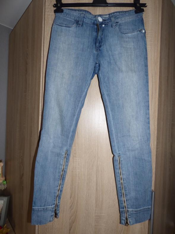 Spodnie cygaretk jeans Lee z zamkami przy kostkach