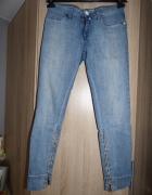 Spodnie cygaretk jeans Lee z zamkami przy kostkach...
