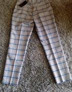 Eleganckie spodnie damskie w kantkę Reserved